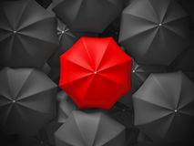 Parapluie différent de rouge au-dessus de beaucoup de parapluies noirs Leade d'affaires Image libre de droits