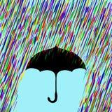 Parapluie sous la pluie colorée Photos stock