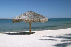 Parapluie sur la plage de Paz de La Images libres de droits