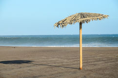 paraply för strandbegreppsferie Royaltyfria Foton