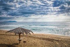 paraply för strandbegreppsferie Royaltyfri Fotografi