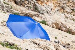 paraply för strandbegreppsferie Fotografering för Bildbyråer