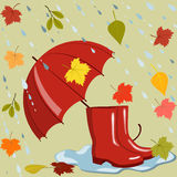 Paraply, kängor och höstsidor Arkivbilder