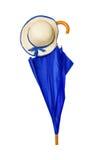 Paraply och hatt på vit bakgrund Royaltyfria Bilder