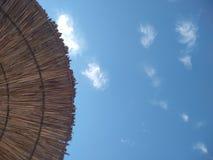 Paraply på stranden royaltyfria bilder