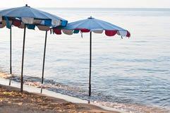Paraply på stranden Royaltyfri Foto