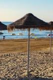 Paraplyer på stranden Arkivfoto