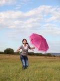 paraplykvinna arkivbild