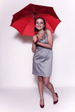 paraplykvinnabarn royaltyfri foto