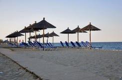Parasóis na praia Imagens de Stock