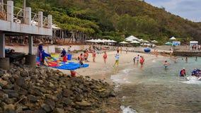 Parasailer prepares to start from beach over sea on island. NHA TRANG, KHANH HOA/VIETNAM - SEPTEMBER 11 2015: Panorama of beach near resort parasailer prepares stock footage