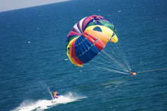 Parasailers being rescued. Parasailers in tandem being rescued by man on sky-jet Royalty Free Stock Photography