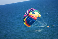 Parasailers crashing in sea. Parasailers in tandem crashing into the sea Royalty Free Stock Photo