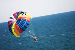 Parasailig at low altitude. Parasailers in tandem at low altitude Stock Photography