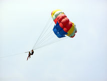 Parasailing. Couple parasailing stock photo