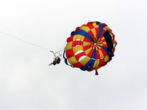 Parasailing. Couple parasailing stock photos