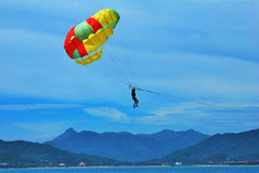Parasailing. Some people are parasailing over the sea Royalty Free Stock Image