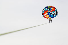 Parasailing. Two parasailers high above the ocean Stock Photo