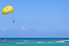 Parasailing. Some people are parasailing over the caribbean sea stock images