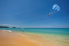 Parasailing above beach Stock Photos