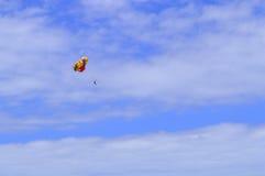 Parasailing above Playa De Las Americas beach Stock Photos