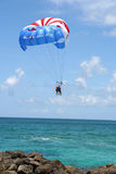 Parasailing Activity. Parasailing people high in the air on a beautiful day royalty free stock photo