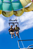 Parasailing adventure with a blue sky Stock Photos