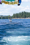 Parasailing adventure on the lake. Coeur d' Alene, Idaho - August 12: Exiting summer parasailing adventure in lake Coeur d' Alene. August 12 2016, Coeur d' Alene Stock Image
