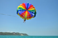 Parasailing adventure over clear blue waters Stock Image