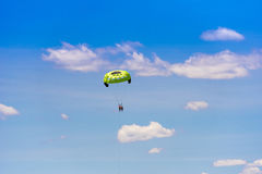 Parasailing against a background of clouds and blue sky. Copy space for text. Royalty Free Stock Images
