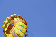 Parasailing against blue sky Royalty Free Stock Image