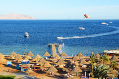 Parasailing and beach of luxury hotel Stock Photos