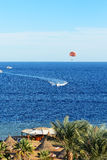 Parasailing and beach of luxury hotel Stock Photo
