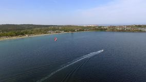 Parasailing in Black Sea in front of sandy beaches in Bulgaria Sozopol with wind of summer stock footage