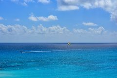 Parasailing in the blue sea stock images