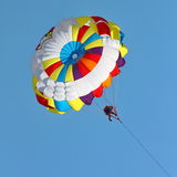 Parasailing in a blue sky. Royalty Free Stock Image