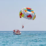 Parasailing in a blue sky. Stock Images