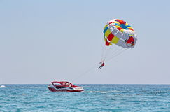 Parasailing in a blue sky. Royalty Free Stock Photos