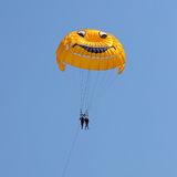 Parasailing in a blue sky Stock Images