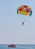 Parasailing in a blue sky Stock Photo
