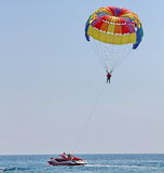 Parasailing in a blue sky Royalty Free Stock Photo