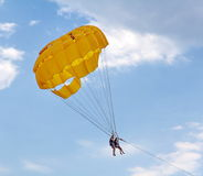 Parasailing in a blue sky near sea beach Stock Images