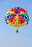 Parasailing in a blue sky near sea beach Royalty Free Stock Photos
