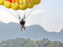 Parasailing in a blue sky near sea beach Royalty Free Stock Images