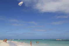 Parasailing in a blue sky over Bavaro Beach in Punta Cana, Dominican Republic Royalty Free Stock Photos