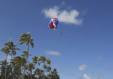 Parasailing in a blue sky in Punta Cana, Dominican Republic Royalty Free Stock Image