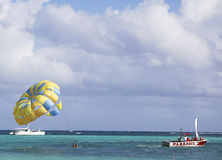 Parasailing in a blue sky in Punta Cana, Dominican Republic Royalty Free Stock Photos