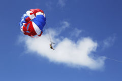 Parasailing in a blue sky in Punta Cana, Dominican Republic Stock Images