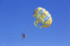 Parasailing in a blue sky in Punta Cana, Dominican Republic stock photo