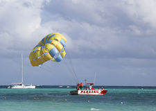 Parasailing in a blue sky in Punta Cana, Dominican Republic. PUNTA CANA, DOMINICAN REPUBLIC - DECEMBER 31: Parasailing in a blue sky in Punta Cana on December 31 Royalty Free Stock Image